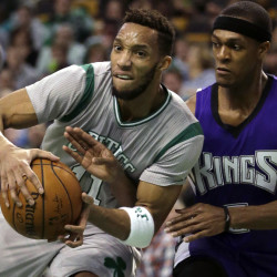 Evan Turner, left, of the Celtics drives against a former Boston teammate, Sacramento point guard Rajon Rondo, during the Celtics' 128-119 win Sunday afternoon at the TD Garden.