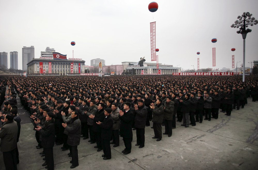 North Koreans gather at the Kim Il Sung Square to celebrate a satellite launch, Monday in Pyongyang, North Korea.