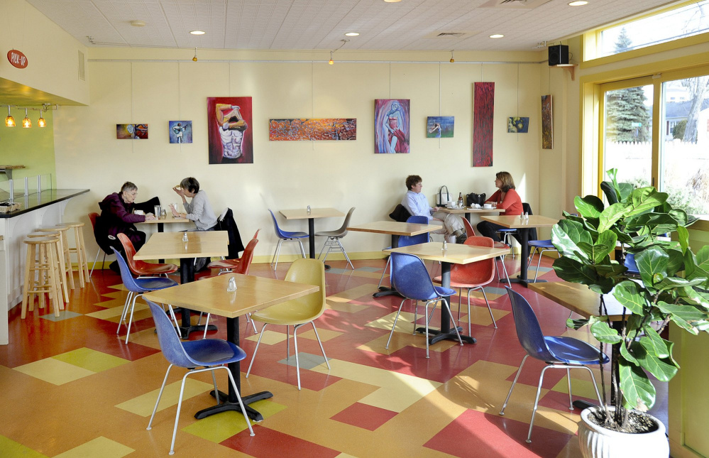 Diners eat at Borealis' Bakery & Bistro on Ocean Avenue in Portland, which will close Saturday.