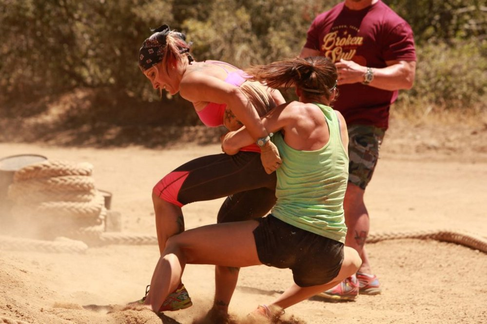 "Portland fitness instructor Jodi Theriault, left, is seen competing on the CMT series ""Steve Austin's Broken Skull Challenge."" The episode will air at 8 p.m. Sunday."