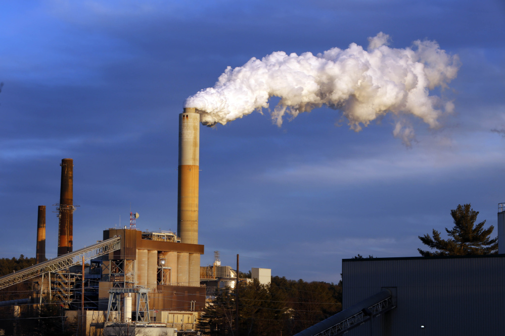 A plume of steam billows from the coal-fired Merrimack Station in Bow, N.H. The U.S. Supreme Court on Tuesday halted enforcement of President Obama's plan to address climate change by reducing carbon dioxide emissions at existing power plants.