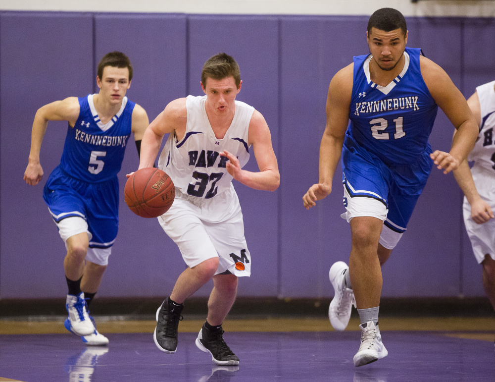 Ben Beers of Marshwood finds room to dribble up the court between Justin Wiggins, left, and Travon Bradford of Kennebunk during Marshwood's 63-54 victory in a Class A South prelim Tuesday night.
