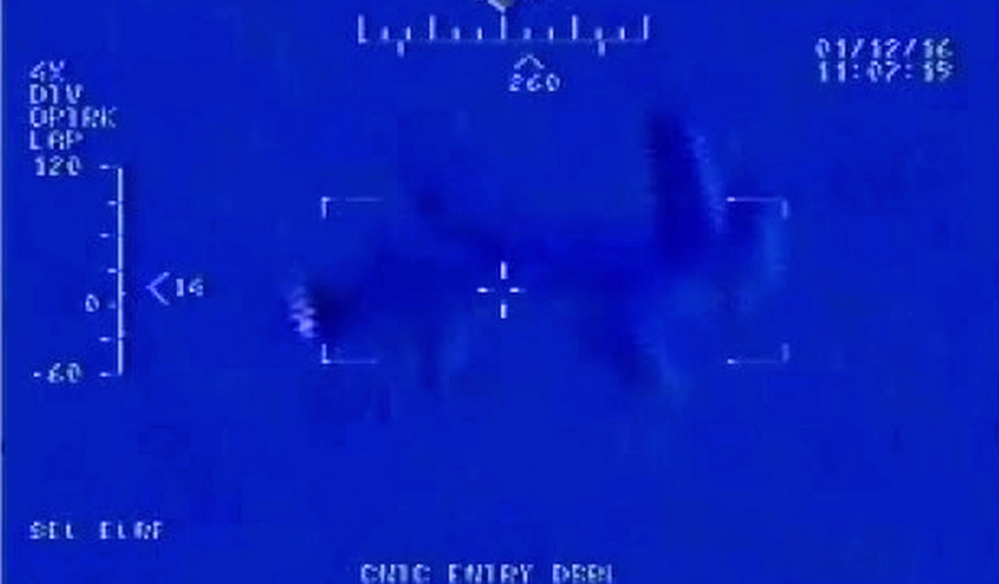 "This Jan. 12, 2016, still image taken from video made available by the U.S. Navy shows Iranian drone"" Shaheed "" as it flies over the USS Harry S. Truman."