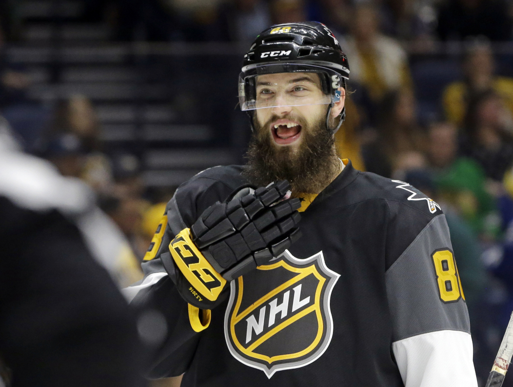 In this Sunday, Jan. 31, 2016, file photo, Pacific Division defenseman Brent Burns (88), of the San Jose Sharks, talks with a referee during the NHL hockey All-Star championship game in Nashville, Tenn.