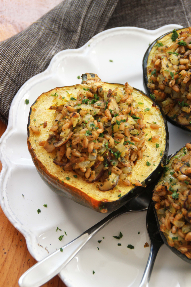 And since the bowl-like shape of the squash just begs to be filled, we created a mushroom-farro stuffing spiked with lemon zest and juice.   The Associated Press