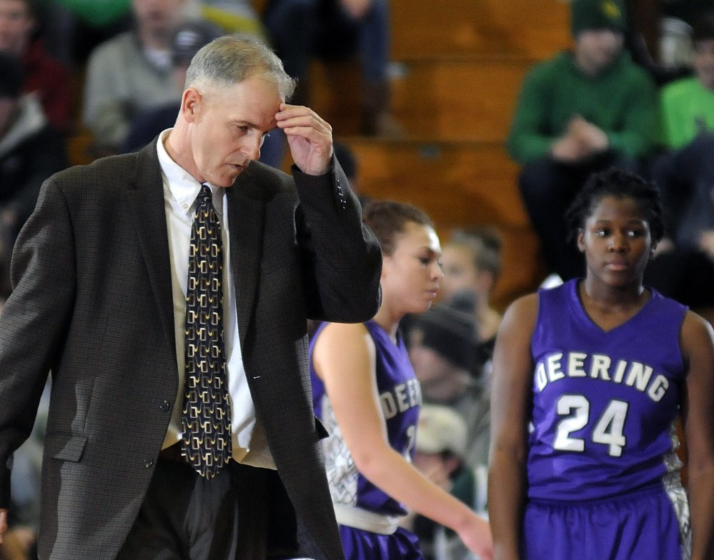 Deering Coach Mike Murphy collects his thoughts during a timeout Tuesday in a Class A North girls' basketball semifinal against Oxford Hills, which scored the game's last eight points to secure a 45-35 win.