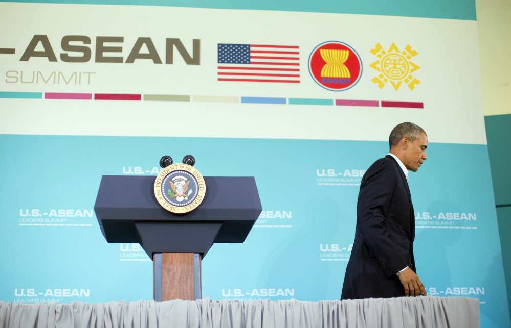 President Barack Obama walks away from the podium at the end of a news conference following the conclusion of the Association of Southeast Asian Nations (ASEAN) leaders summit at the Annenberg Retreat at Sunnylands in Rancho Mirage, Calif., Tuesday.