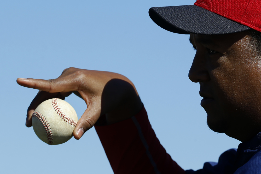 Pedro Martinez, special assistant to the Boston Red Sox general manager, gestures as he mentors pitchers during a spring-training session.