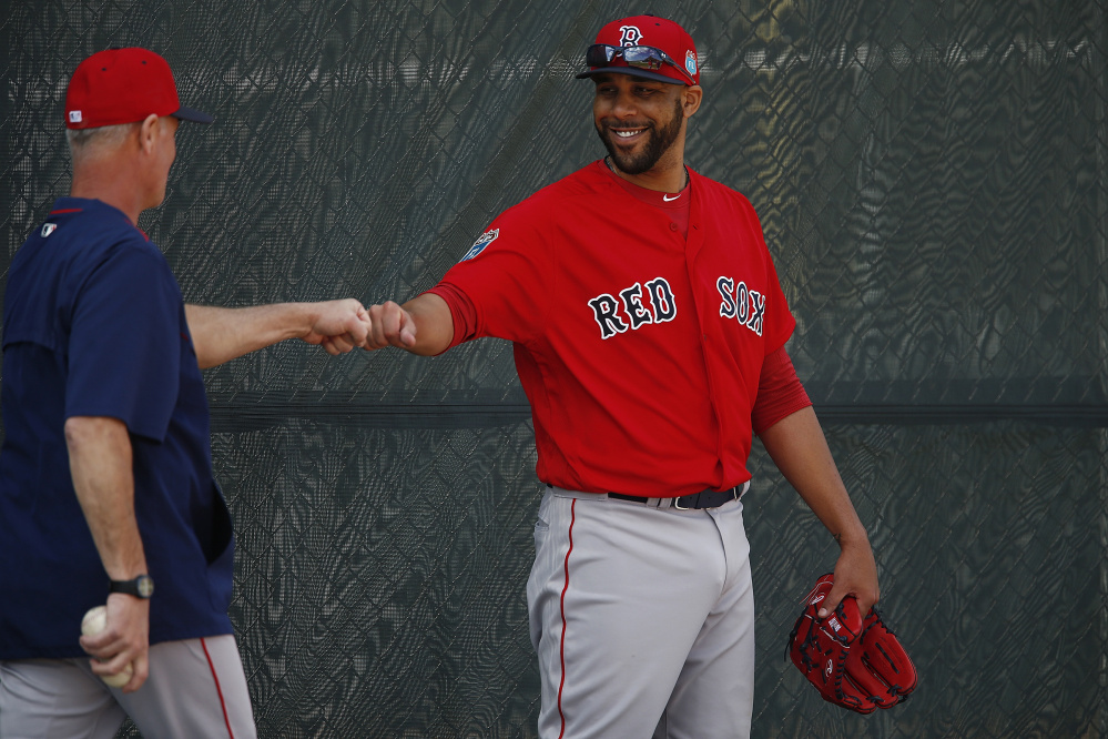 Bob Kipper, left, AAA Pawtucket Sox pitching coach, left, fist bumps Boston Red Sox starting pitcher David Price during spring training baseball, Friday, Feb. 19, 2016, in Fort Myers, Fla. (Corey Perrine/Naples Daily News via AP)  FORT MYERS OUT; MANDATORY CREDIT