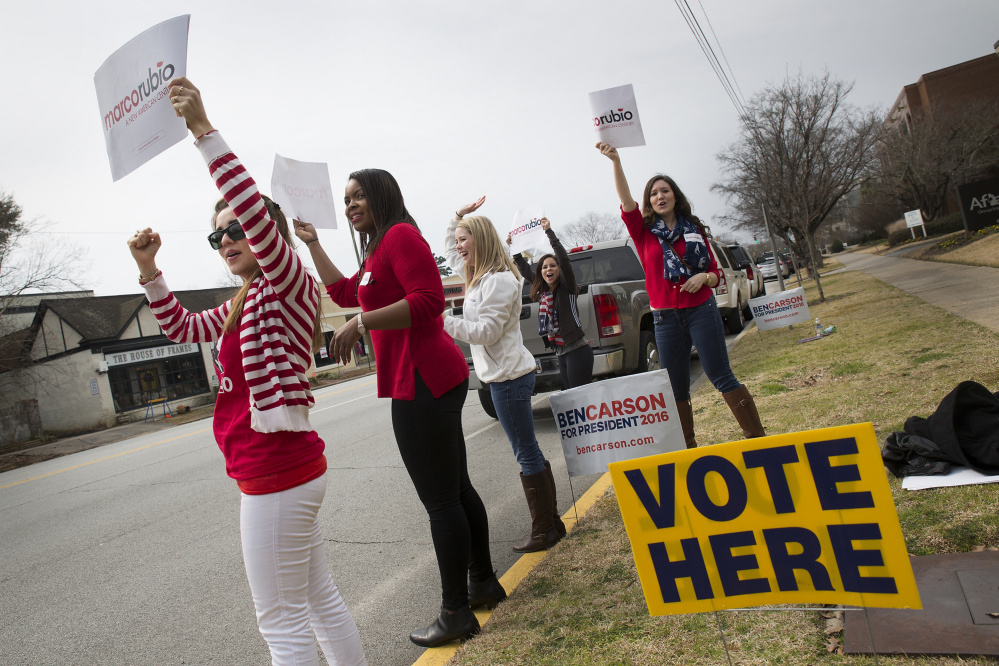 Marco Rubio supporters shout to passing drivers in Columbia, S.C. Polling shows that close to 40 percent of South Carolina voters favor candidates who share their values.