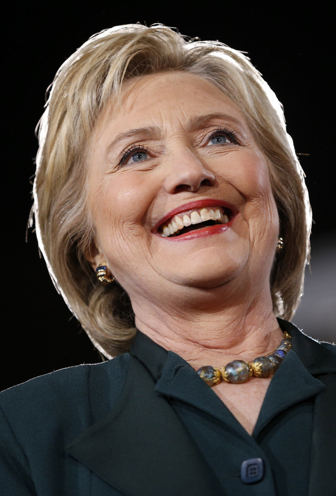 Democratic presidential candidate Hillary Clinton stands on stage during a rally Friday, Feb. 19, 2016, in Las Vegas. (AP Photo/John Locher)
