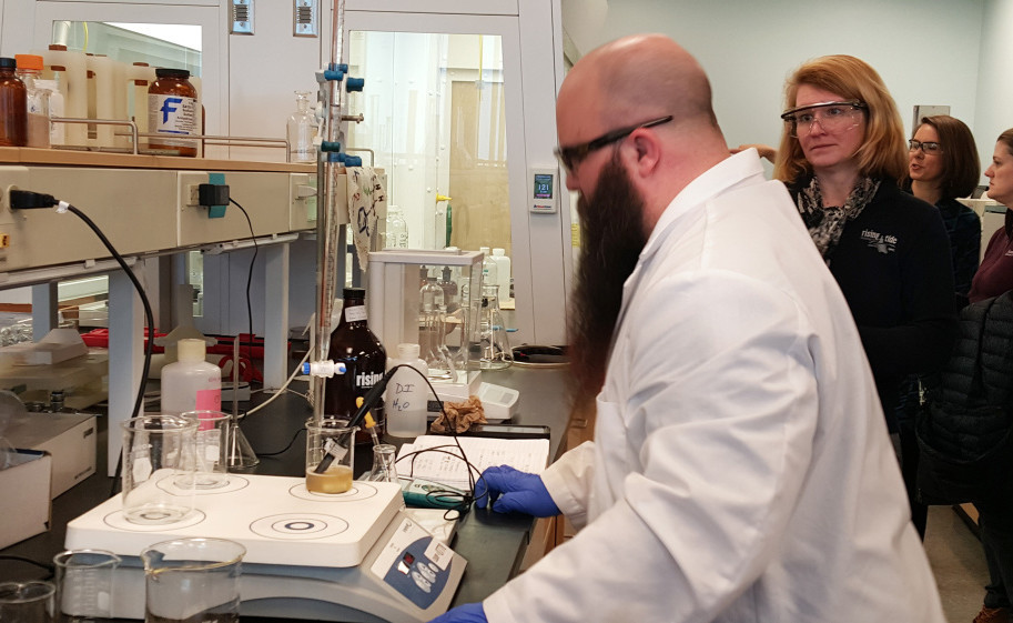 Ryan Michaud, a University of Southern Maine student, checks acidity levels in a Rising Tide beer as Rising Tide Brewing Co. co-owner Heather Sanborn watches on Thursday morning.