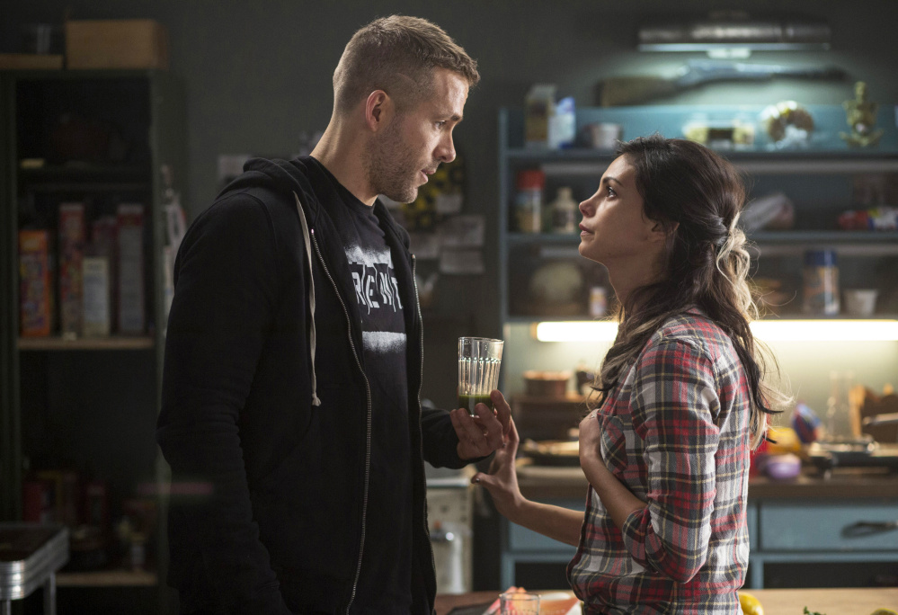 """Ryan Reynolds and Morena Baccarin appear in a scene from the film """"Deadpool"""" from Twentieth Century Fox."""