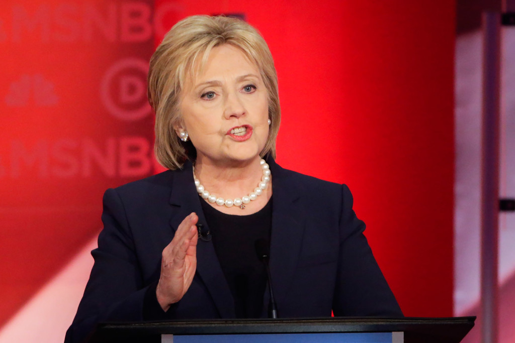 Hillary Clinton makes her opening statement in Thursday night's debate in Durham, N.H. She later told Bernie Sanders,