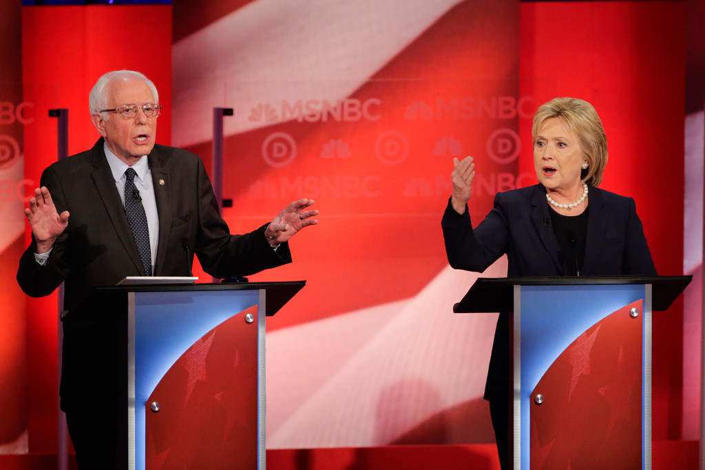 Bernie Sanders and Hillary Clinton spar during Thursday night's debate at the University of New Hampshire. The candidates differed over how to achieve liberal goals and Sanders' effort to cast Clinton as beholden to Wall Street. The Associated Press