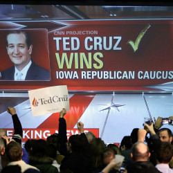 Ted Cruz supporters cheer as caucus returns show Cruz first in the Republican field.