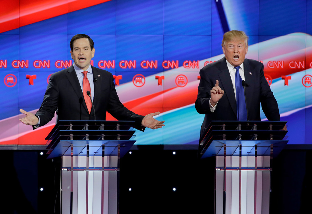 Marco Rubio and Donald Trump try to speak over each other during Thursday night's debate. Rubio said that if Trump