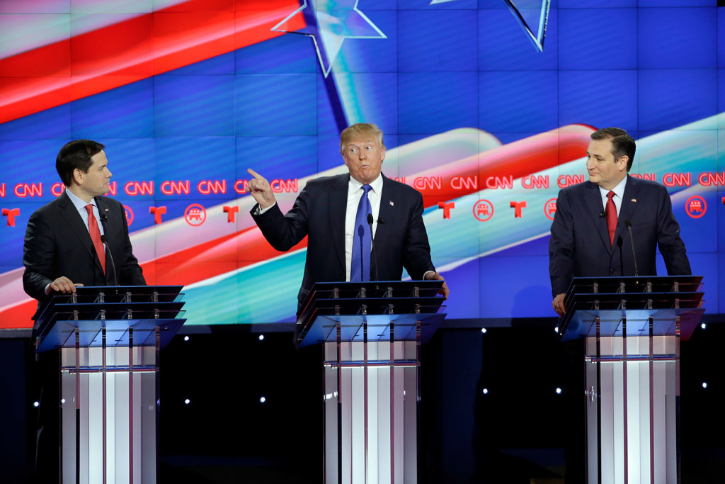 Donald Trump speaks as Marco Rubio, left, and Ted Cruz listen during Thursday night's debate. Trump, the front-runner in the race, and his two top rivals clashed from the start of the debate. The Associated Press