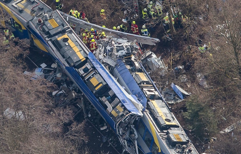 Rescue workers comb through wreckage at the site of a train collision near Bad Aibling,Germany, Tuesday. Photo by Peter Kneffel/dpa via AP