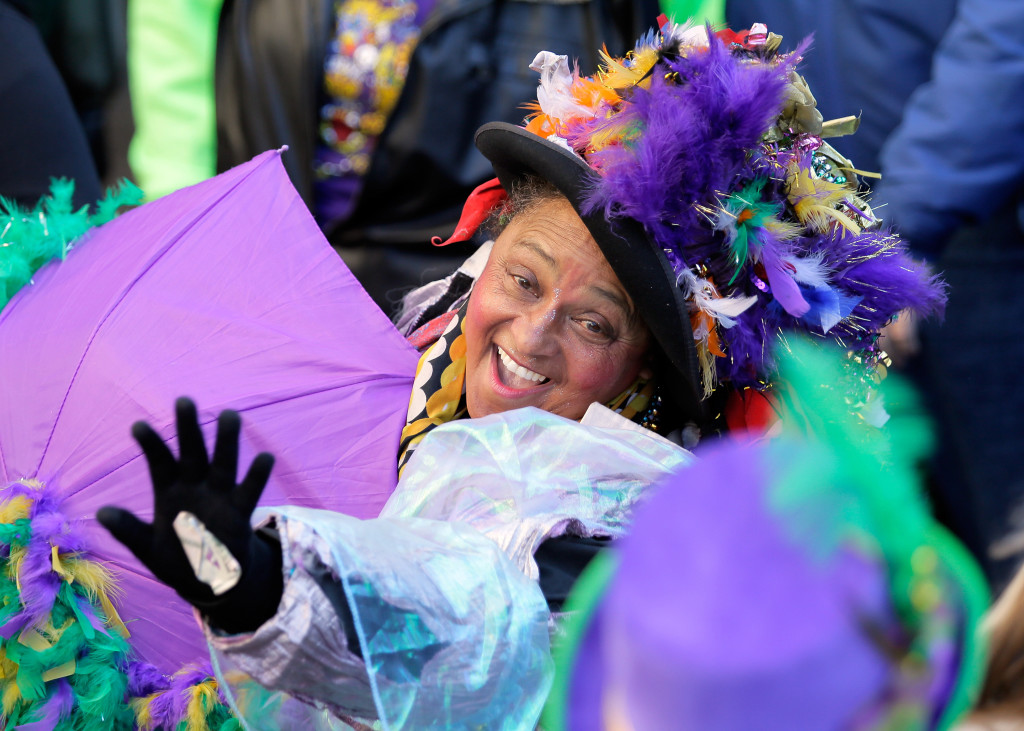 Zulu rolls down St. Charles Avenue in New Orleans.  Dressed in elaborate costumes, dancing to the beat of brass bands and clamoring for beads from passing floats, thousands of people gathered in the streets of New Orleans to mark the culmination of the famous Mardi Gras celebration Tuesday.