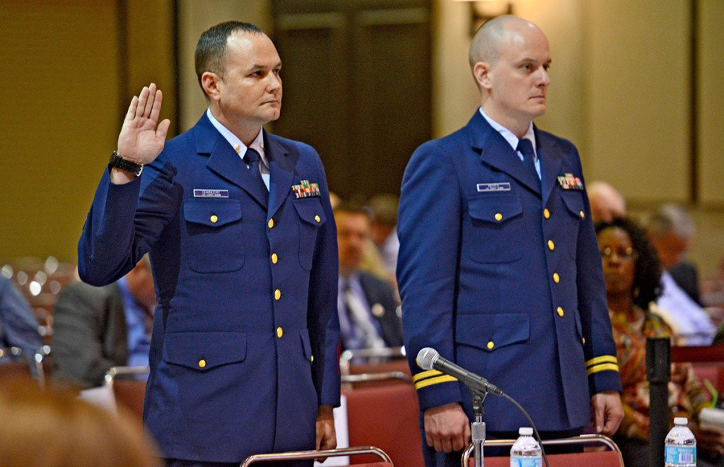 Petty Officer 2nd Class Matthew Chancery, left, is sworn in to start the day while standing next to his counsel, Lt. Travis Noyes,  as a Coast Guard hearing into the sinking of the El Faro continues in Jacksonville, Fla., Wednesday. Bob Mack/The Florida Times-Union via AP
