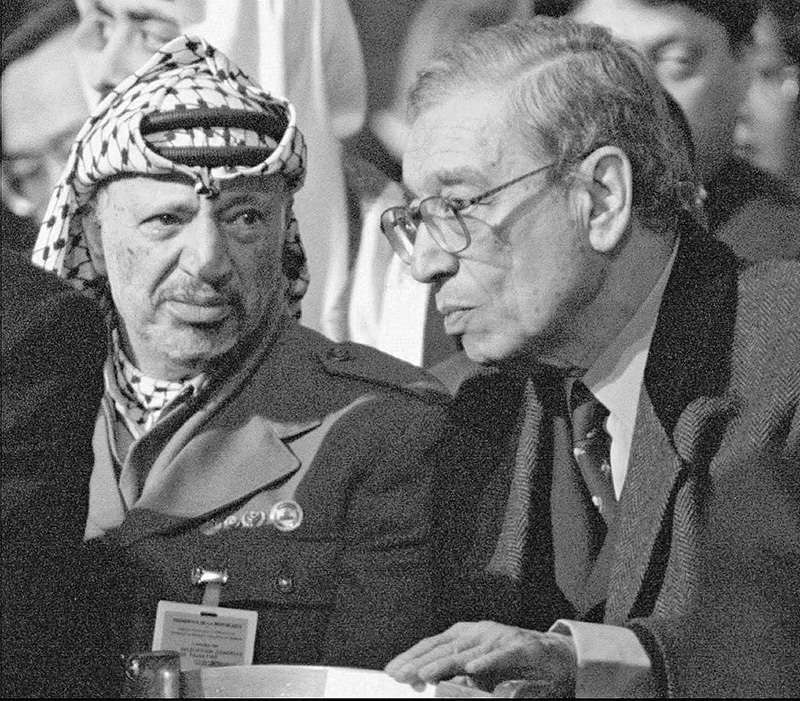 In this  Jan. 11, 1996, photo, then-U.N. Secretary General Boutros Boutros-Ghali, right, and Palestinian leader Yasser Arafat attend the funeral mass at Notre Dame Cathedral in Paris where world leaders paid their last respects to former French President Francois Mitterrand. The Associated Press