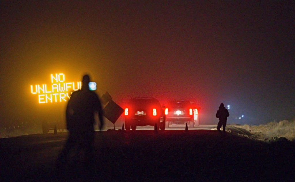 Three SUVs proceed through the Narrows roadblock near Burns, Ore., as FBI agents  surround the remaining four occupiers at the Malheur National Wildlife Refuge. Thomas Boyd/The Oregonian via AP/2016