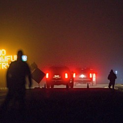Three SUVs proceed through the Narrows roadblock near Burns, Ore., Wednesday night as FBI agents  surround the remaining four occupiers at the Malheur National Wildlife Refuge. Thomas Boyd/The Oregonian via AP