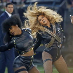 Beyonce performs during halftime of the NFL Super Bowl 50 football game in Santa Clara, Calif. Red Lobster says sales surged 33 percent on Sunday from a year ago. The Associated Press