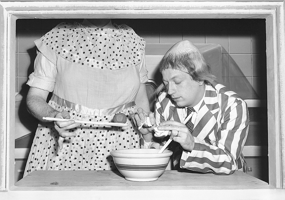 In this Jan. 2, 1952, TV publicity photo, Bob Elliott as Uncle Eugene is instructed in the fine art of making meat ball stuffing by Ray Goulding (face not shown) as Mary McGoon. The Associated Press