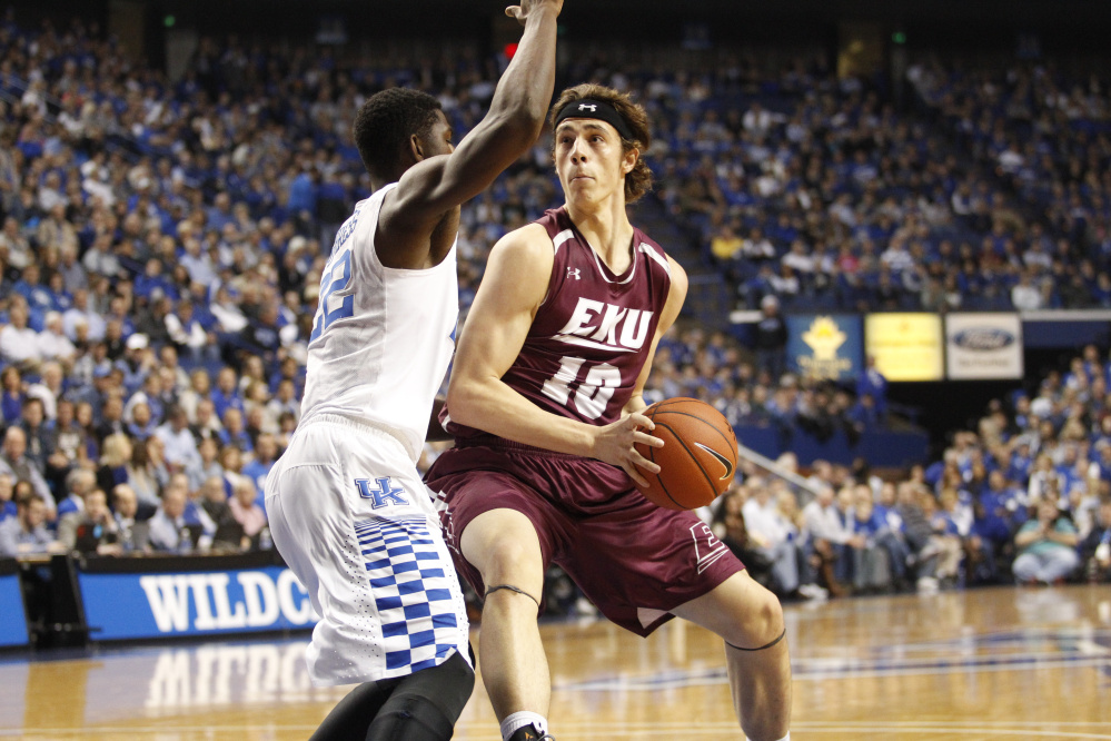 Eastern Kentucky forward Nick Mayo, left, drives to the basket during a game against Kentucky earlier this season. Mayo was named the Ohio Valley Conference Freshman of the Year on Monday. Mayo, a Messalonskee graduate, started all 31 games for the Colonels and averaged 14.5 points a game.