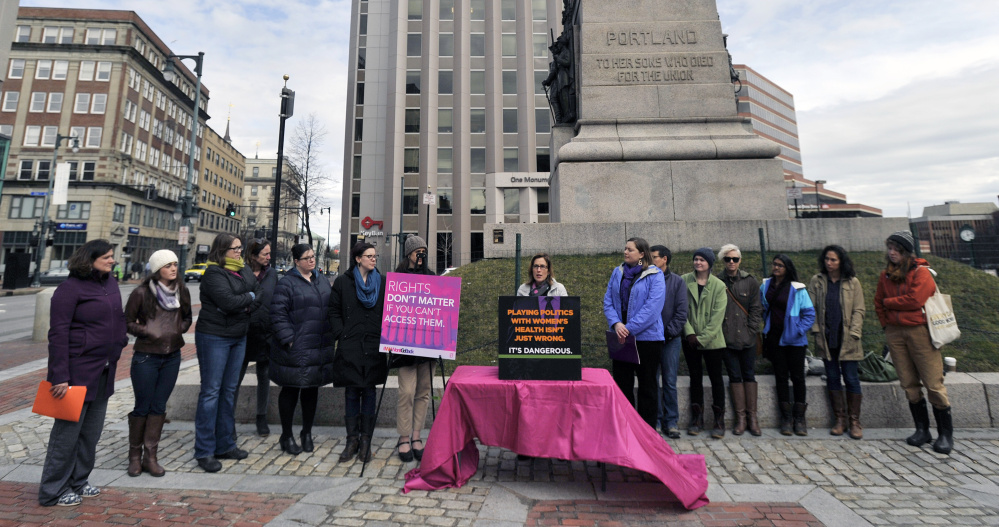 Planned Parenthood, the ACLU of Maine and other groups rally at Monument Square in Portland  arguments before the U.S. Supreme Court on a Texas law that limits the number of abortion clinics on Wednesday.