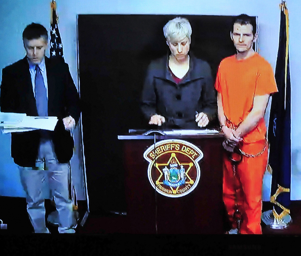 A video screen in Rumford District Court Wednesday shows Derek Cook, his defense attorney Luann Calcagni, and Franklin County Assistant District Attorney Joshua Robbins. Cook was arraigned on seven charges stemming from an escape from a Franklin County Sheriff's Office transport van in Wilton Tuesday.