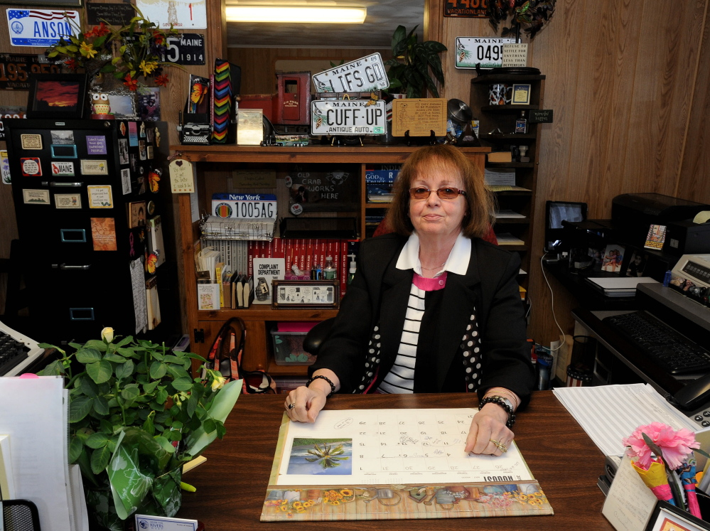 Claudia Viles, Anson's former tax collector, is seen at her desk in Town Hall in August, a month before she resigned. The town collected $1440,000 more in excise taxes in 2015 than in 2014. Viles is charged with 13 counts of fraud, accused of stealing more than $438,000 in town excise taxes between 2011 and 2014.