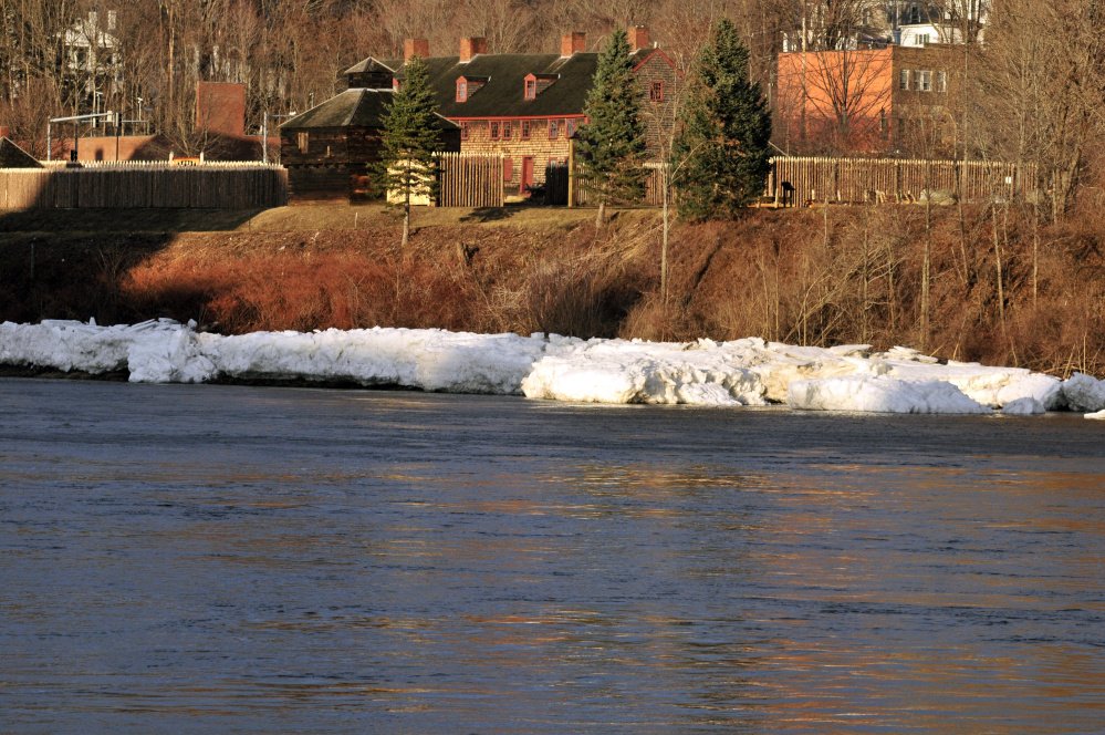 Old Fort Western is seen behind the open waters of the Kennebec River on Wednesday in Augusta.