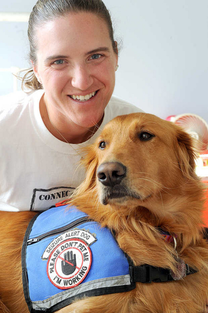"""""""She's absolutely changed my life,"""" Christy Gardner said about her seizure alert dog Moxie."""