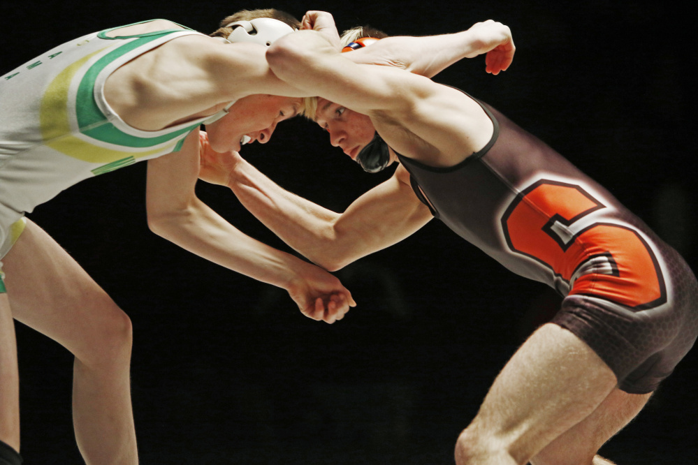 Skowhegan's Cody Craig, right, wrestles Leo Amabile of Massabesic in the 106-pound finas match at the Class A state championships. Craig won and will be the two seed at the New England championships this weekend.
