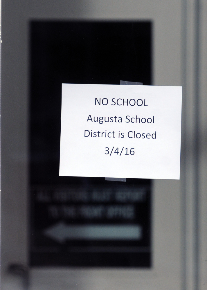 A sign hangs on the front door of Cony High School following a bomb threat on Friday at the school in Augusta.