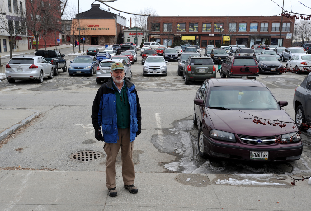 Bill Basford stands in The Concourse parking lot in front of the Napoli Italian Market in downtown Waterville on Friday. Basford says people should park farther away from downtown destinations and walk more.