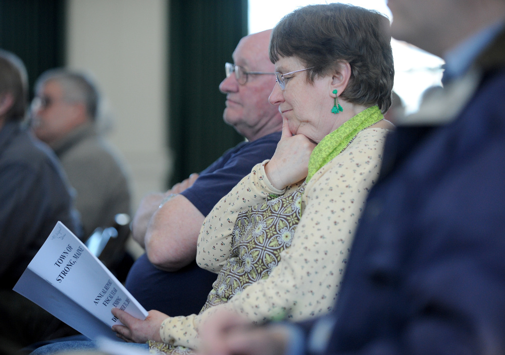 Margaret Huff listens to the day's agenda Saturday during Town Meeting at the Strong Town Hall.