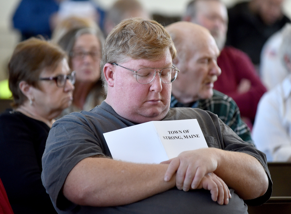 Tom Piekart catches up on some sleep Saturday during Town Meeting at the Strong Town Hall.