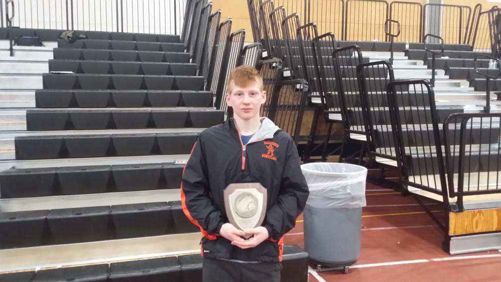 Gardiner senior Peter Del Gallo poses with his championship plaque after he won the 120-pound class title at the New England championships Saturday in Providence, Rhode Island.