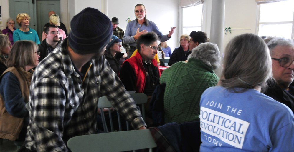 Wilton resident Charles Woodbury makes a point during a well attended Democratic caucus in Wilton on Sunday.