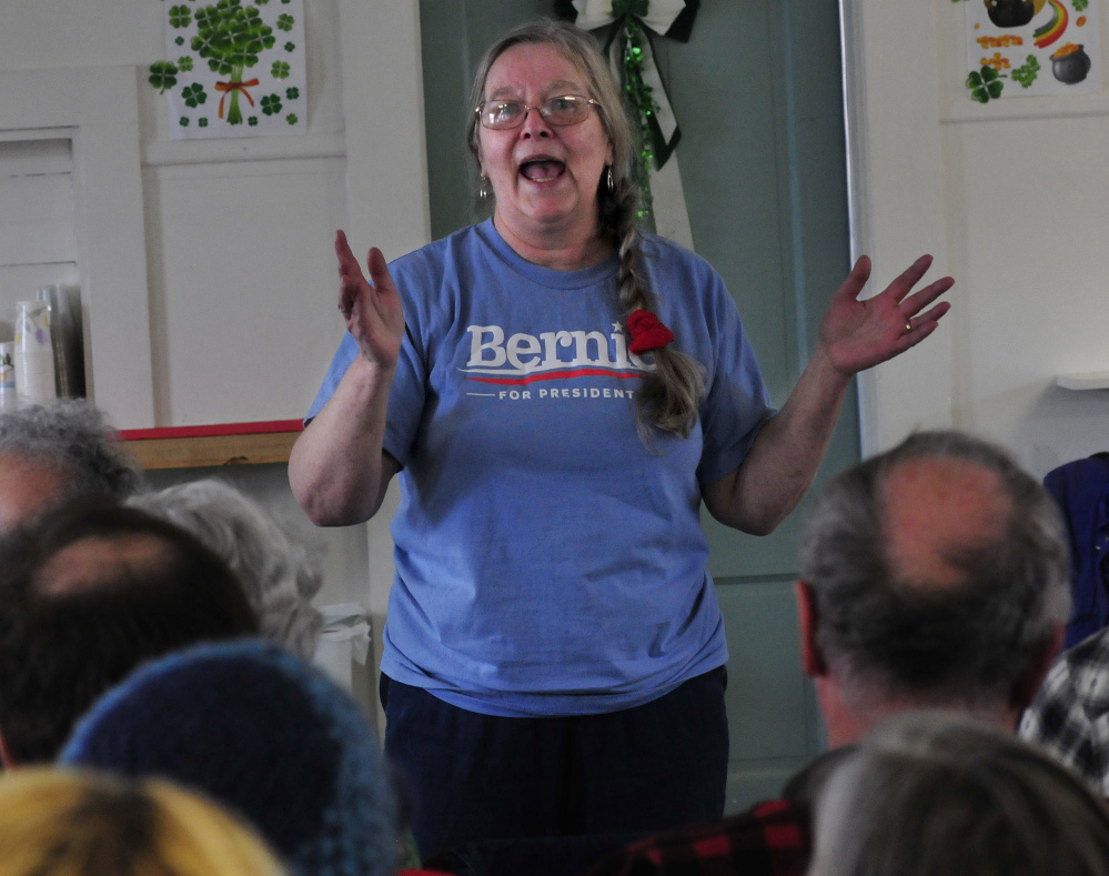 Wilton resident and Bernie Sanders supporter Eileen Adams pitches for her candidate during the Wilton Democratic caucus on Sunday.