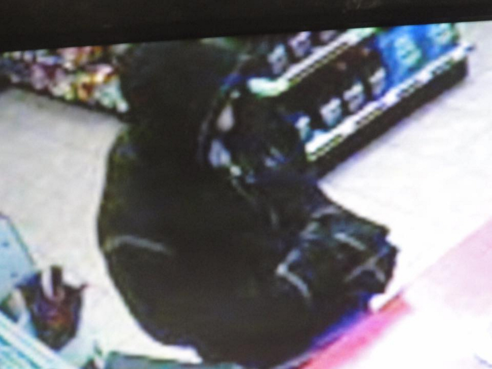 A surveillance camera image of a suspect in a robbery at the Quick Mart in Augusta.