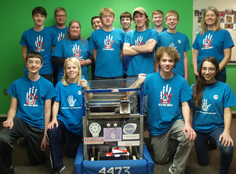 Hall-Dale High School's REM Delta Prime Robotics team, in back, from left, are Neil Stottler, Robert Nitzel, Karen Giles, Micah Thomas, Barry Nitzel, John Wallace, Colt Seigars, Ethan Williams, Isaac Lawrence and Sarah Hodgkins. In front, from left, are Ben Hodgkins, Eli Spahn, William Fahy and Anna Schaab.
