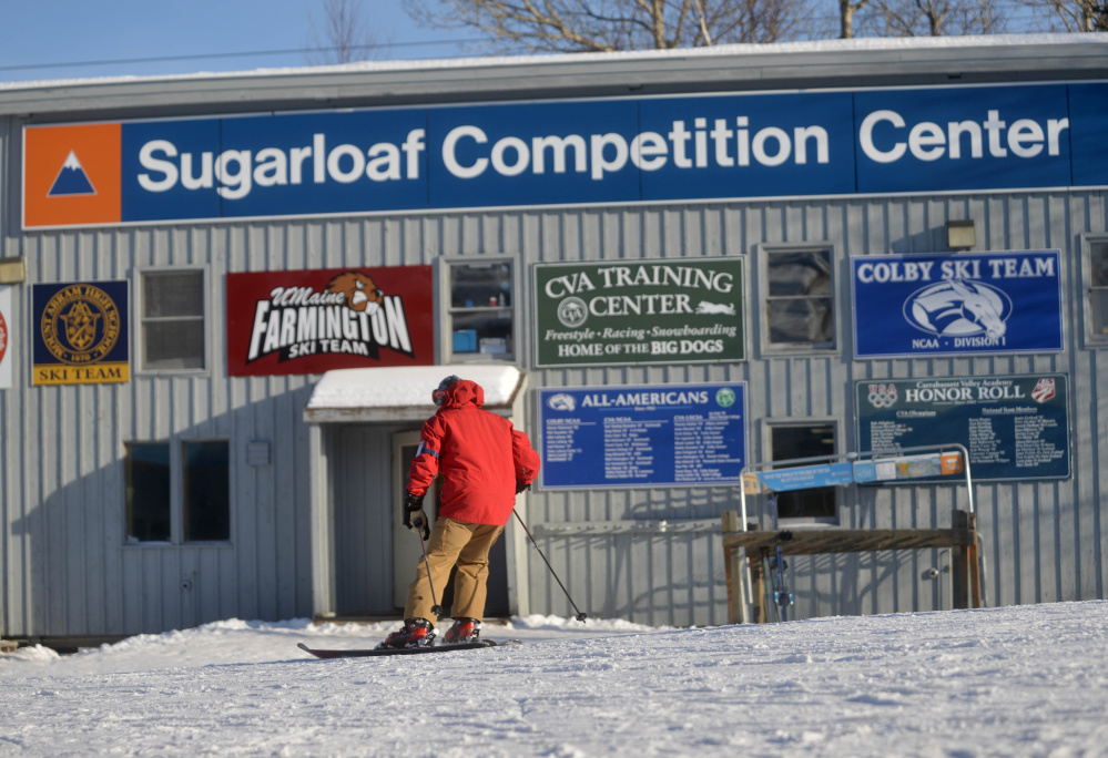 A skier passes the Sugarloaf Competition Center at Sugarloaf Mountain in Carrabassett Valley in January. Carrabasset Valley voters will consider whether to contribute $100,000 to a planned new 11,000-square-foot, $2 million center at Wednesday's Town Meeting.