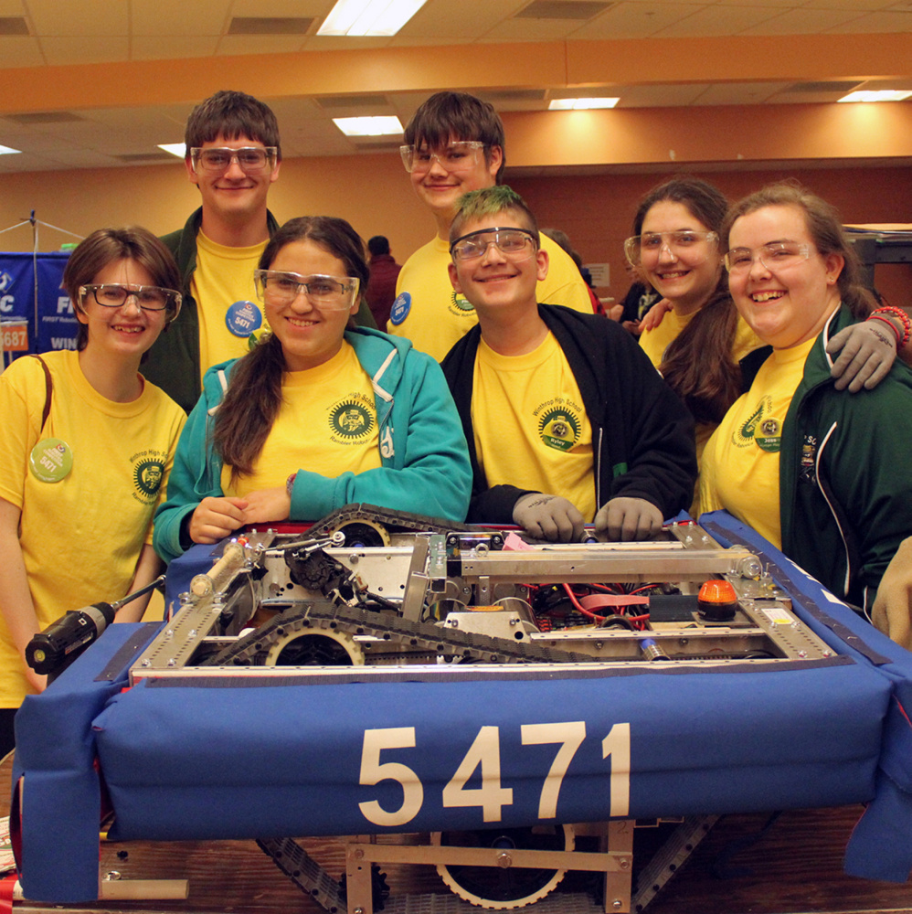 "Team members in back, from left, are Joey Tierney, Phillip Easterbrooks and Portia Hardy. In front, from left, are Emma Dwelle, Fantasia Perez, Ryley Lassor and Jess Tozer pose with the robot, Sir Sherman ""the seige engine"" Tanksalot, Esq. II."