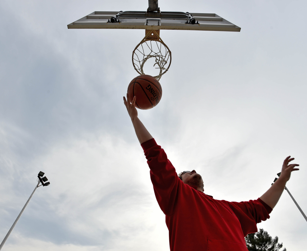 Matt Woods jumps for the rebound as he plays a game of pick-up basketball with two friends at North Street Park in Waterville on Wednesday.