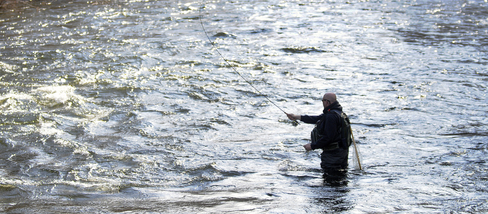 Dennis Skinner, of Monmouth, casts Wednesday in Cobbossee Stream in Manchester. The angler said he fly fished several times this winter.